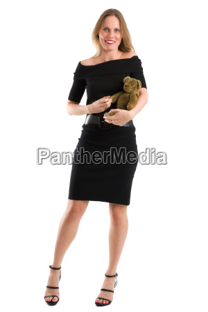 elegant woman canoodling her antique teddy