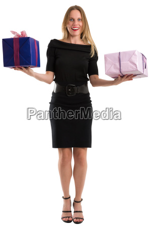 attractive woman juggling big gift packages