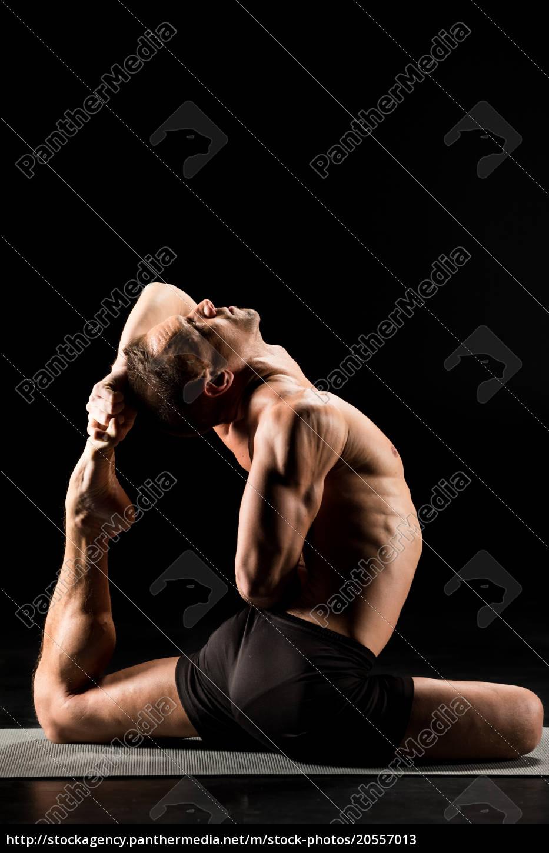 man, sitting, in, yoga, position - 20557013
