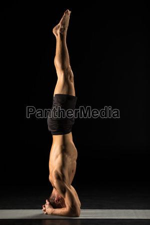 man, standing, in, yoga, position - 20557037