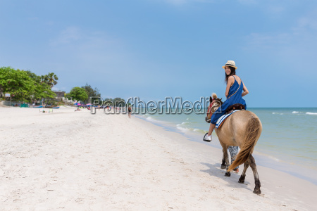 woman, riding, horse, on, sand, beach - 20557841