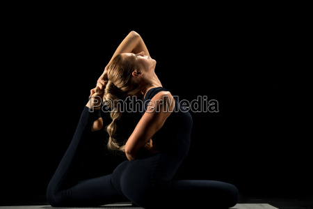 woman, sitting, in, yoga, position - 20557027