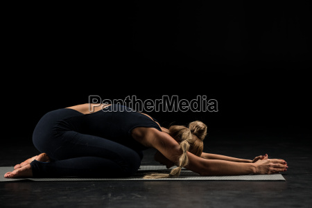 woman, sitting, in, yoga, position - 20557049