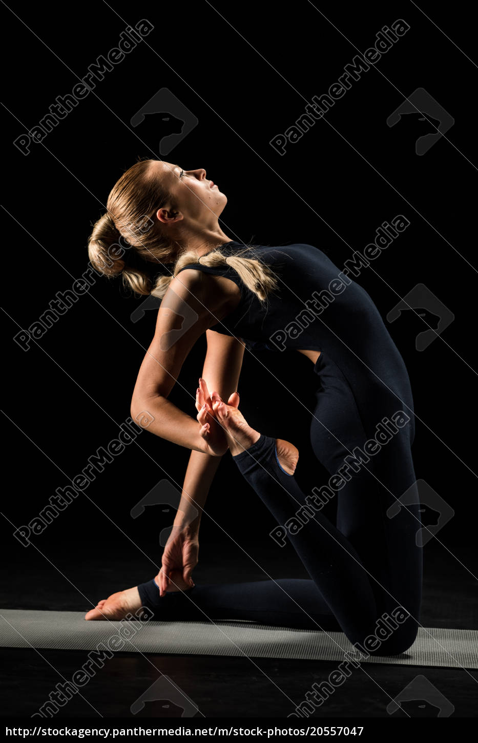 woman, standing, in, yoga, position - 20557047
