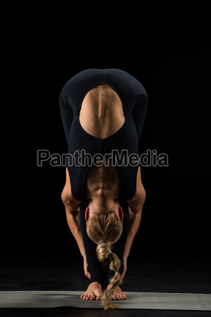 woman, standing, in, yoga, position - 20557051