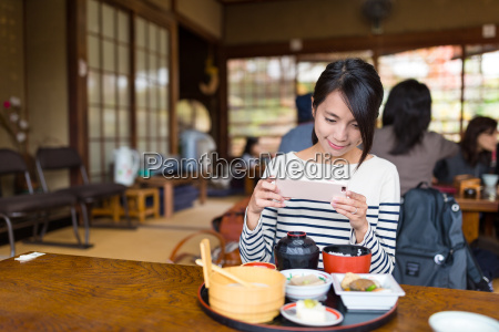 woman, taking, photo, on, her, food - 20557877