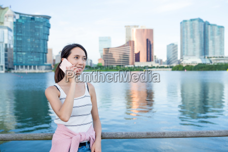 woman, talk, to, cellphone, in, macao - 20557745