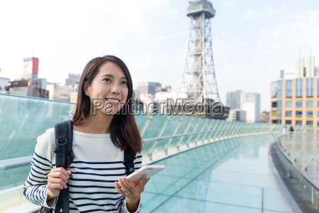 woman, travel, in, nagoya, city - 20557809