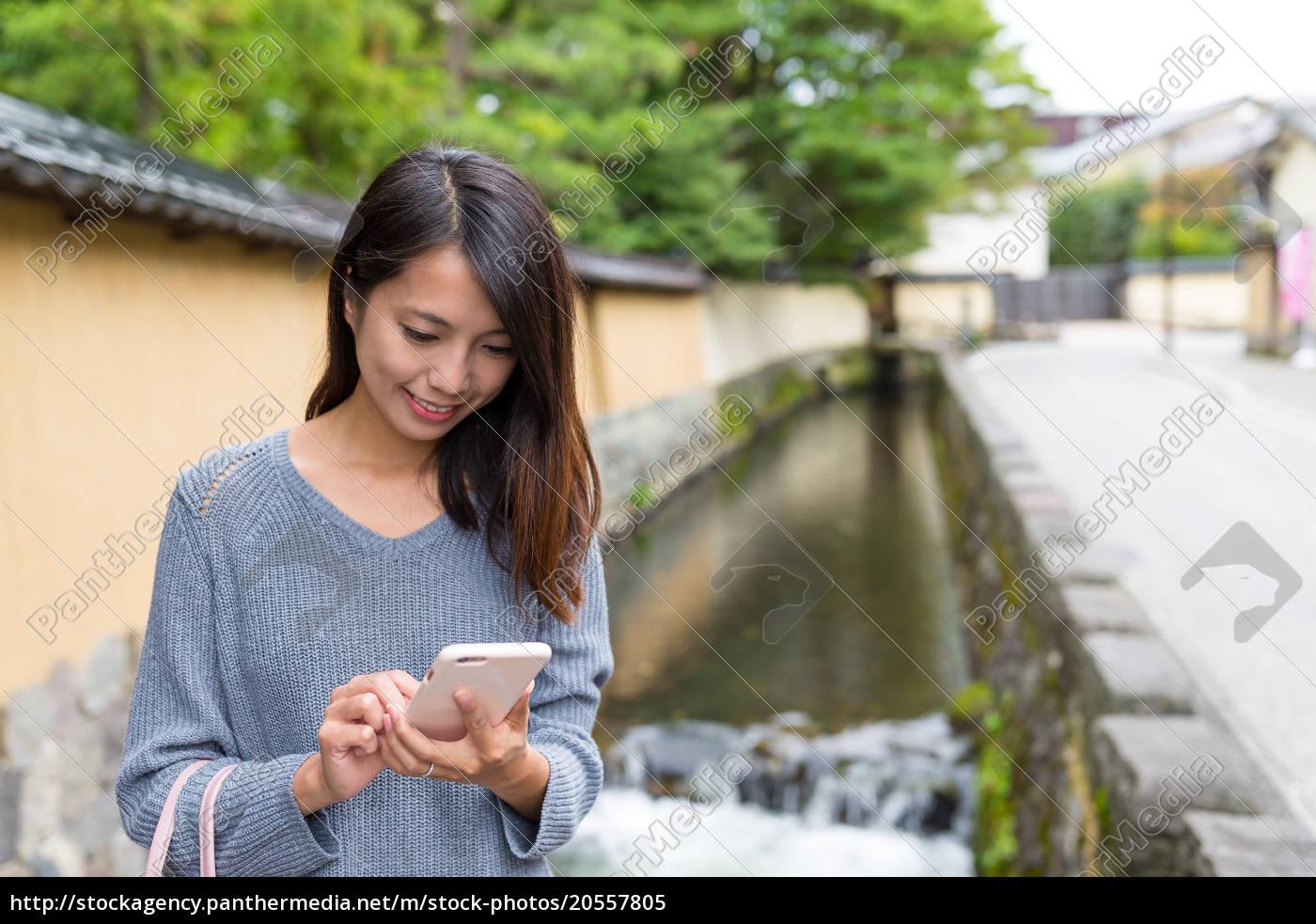 woman, use, of, cellphone, in, kanazawa - 20557805