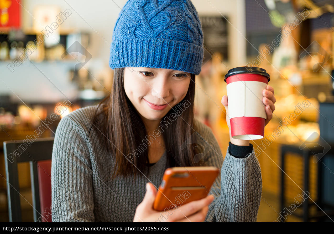 woman, using, mobile, phone, inside, cafe - 20557733