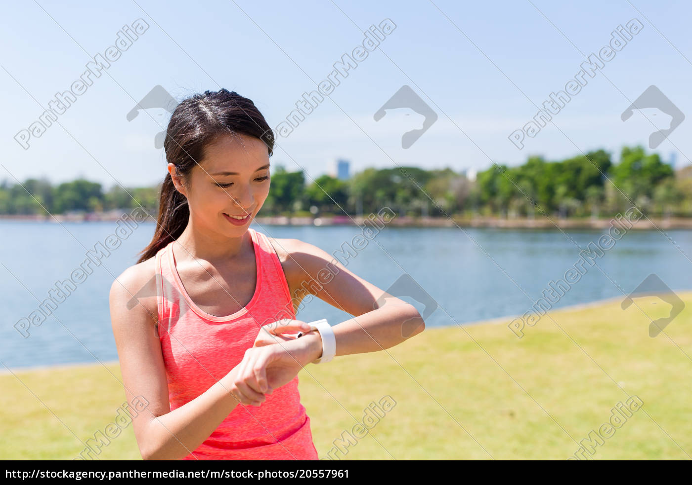 woman, using, smart, watch, at, outdoor - 20557961