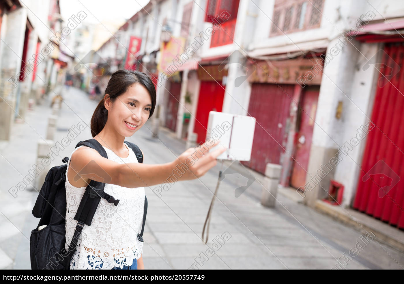 young, woman, taking, selfie, by, digital - 20557749