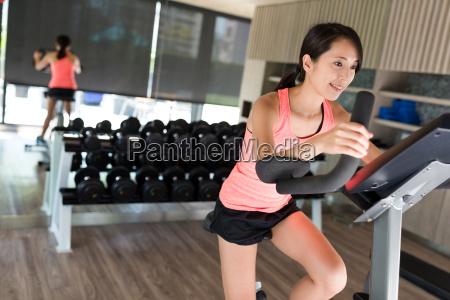 woman doing sport biking in the