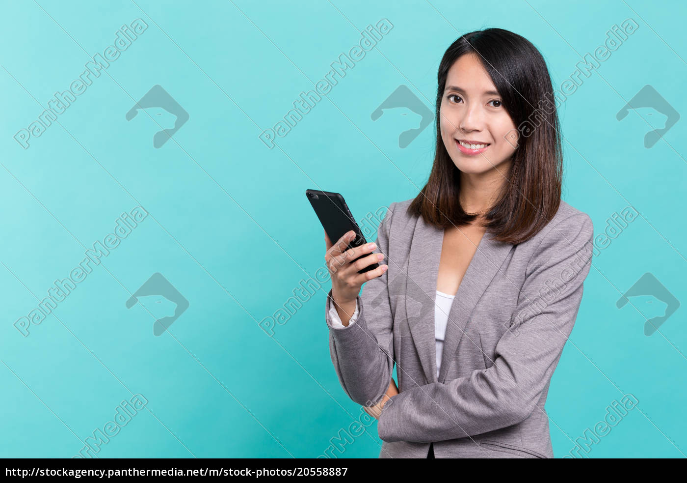 business, woman, use, of, mobile, phone - 20558887