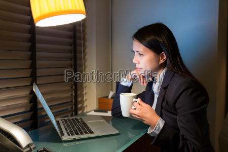 businesswoman, looking, at, laptop, computer, and - 20558931