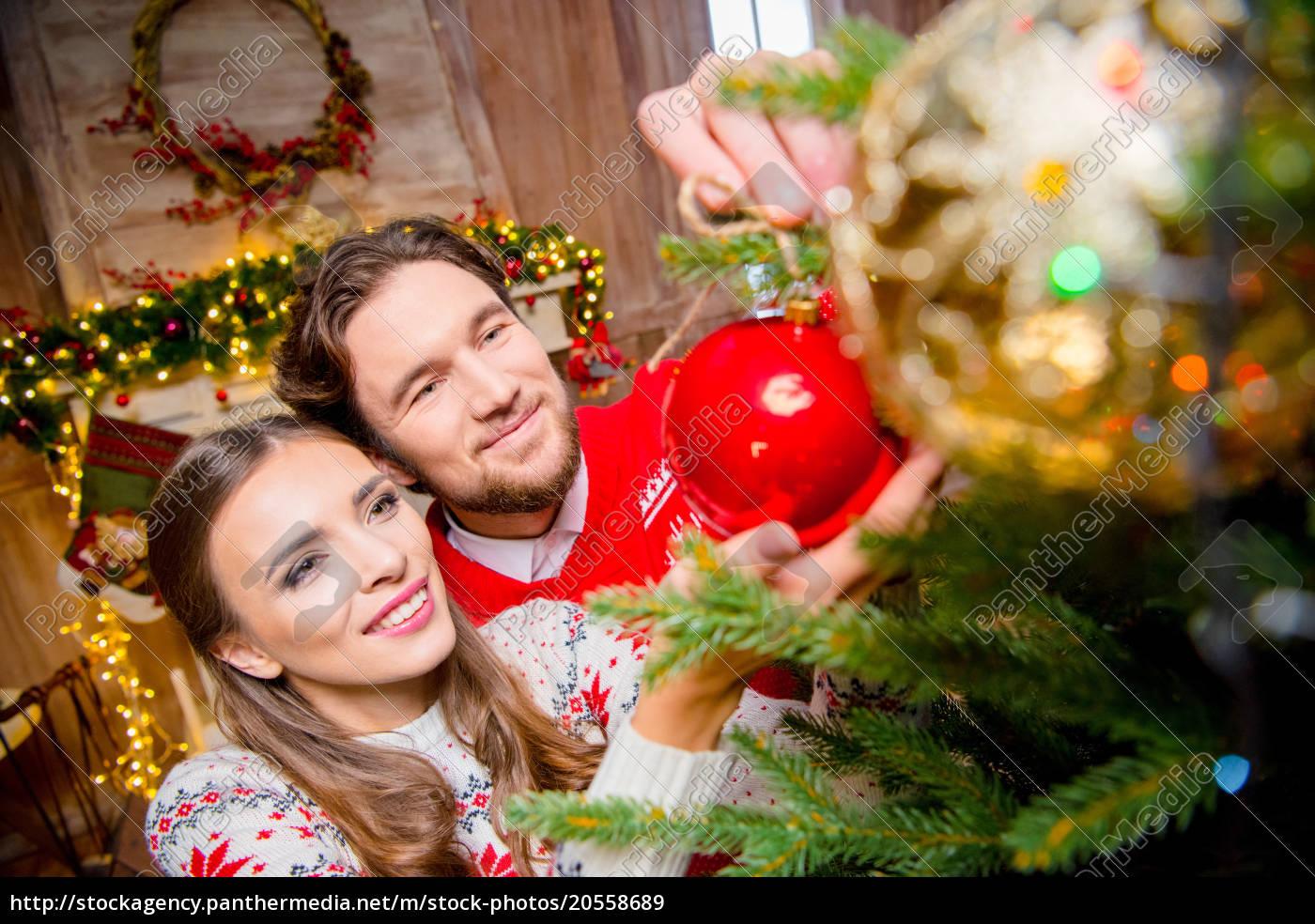 couple, decorating, christmas, tree - 20558689