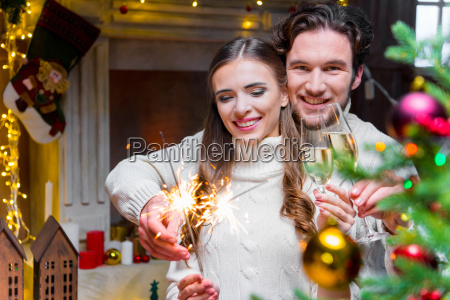 couple, holding, sparklers - 20558703
