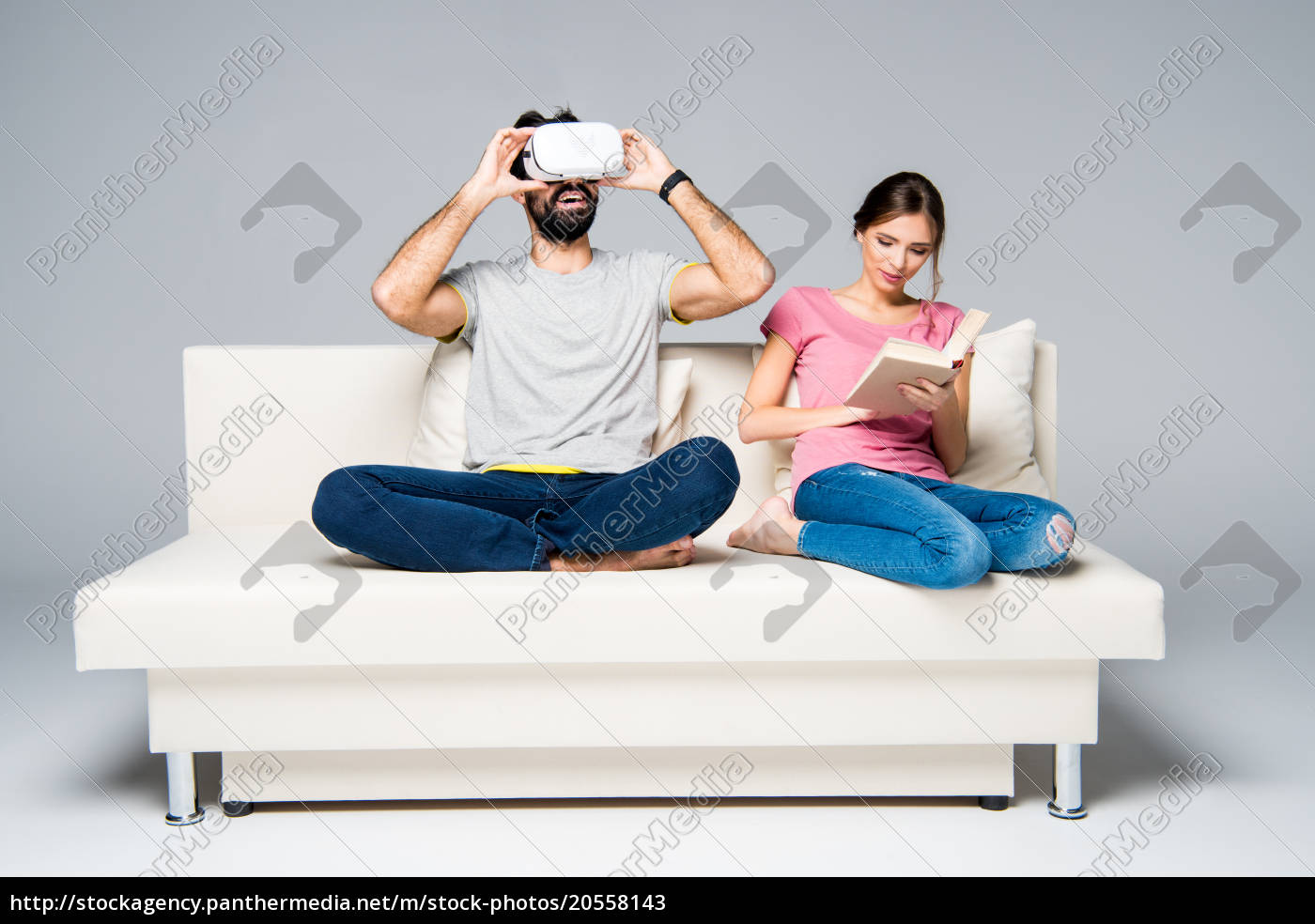 couple, resting, on, white, couch - 20558143