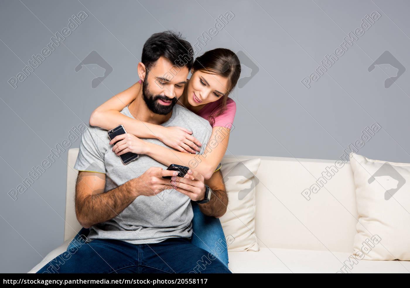 couple, using, smartphones - 20558117