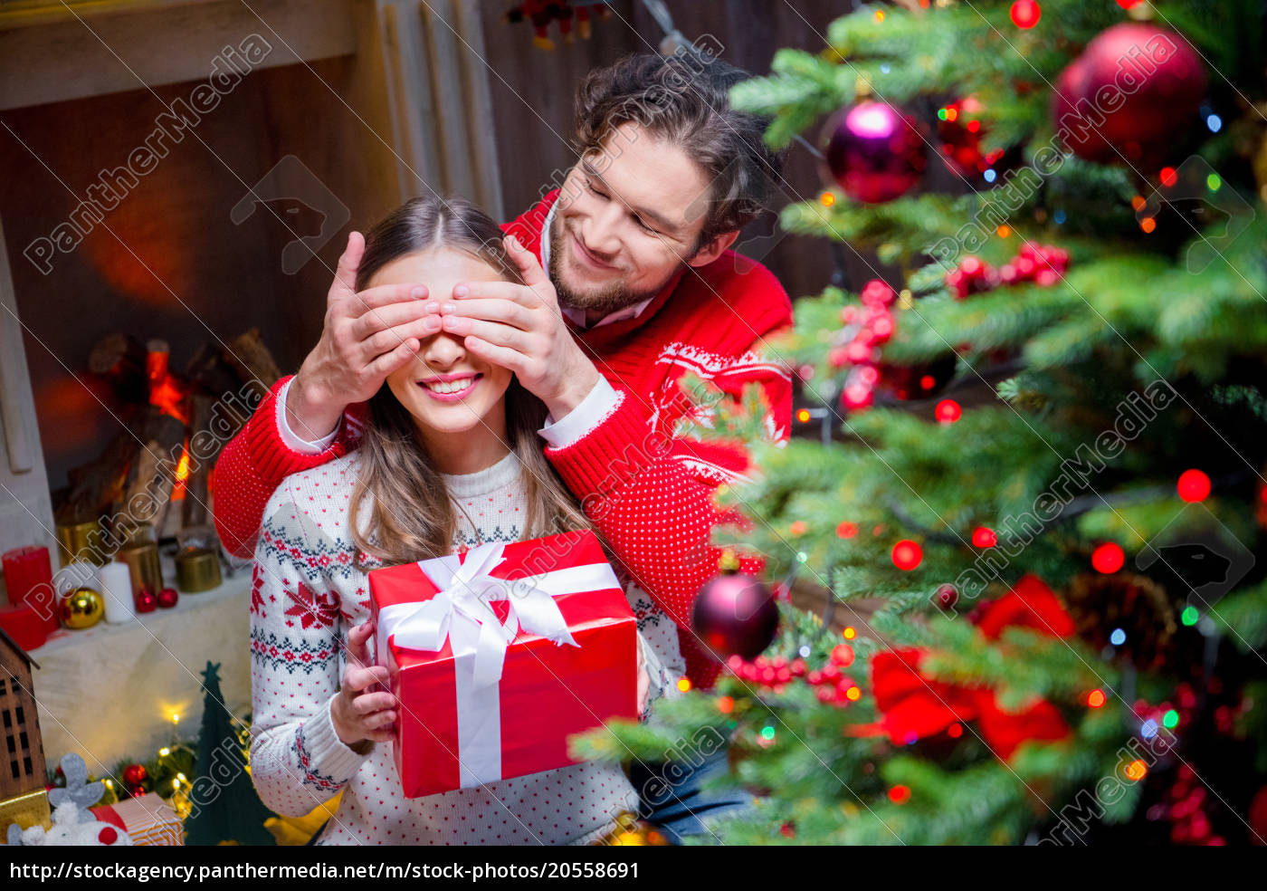 happy, couple, with, christmas, present - 20558691