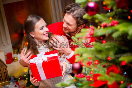 happy, couple, with, christmas, present - 20558695