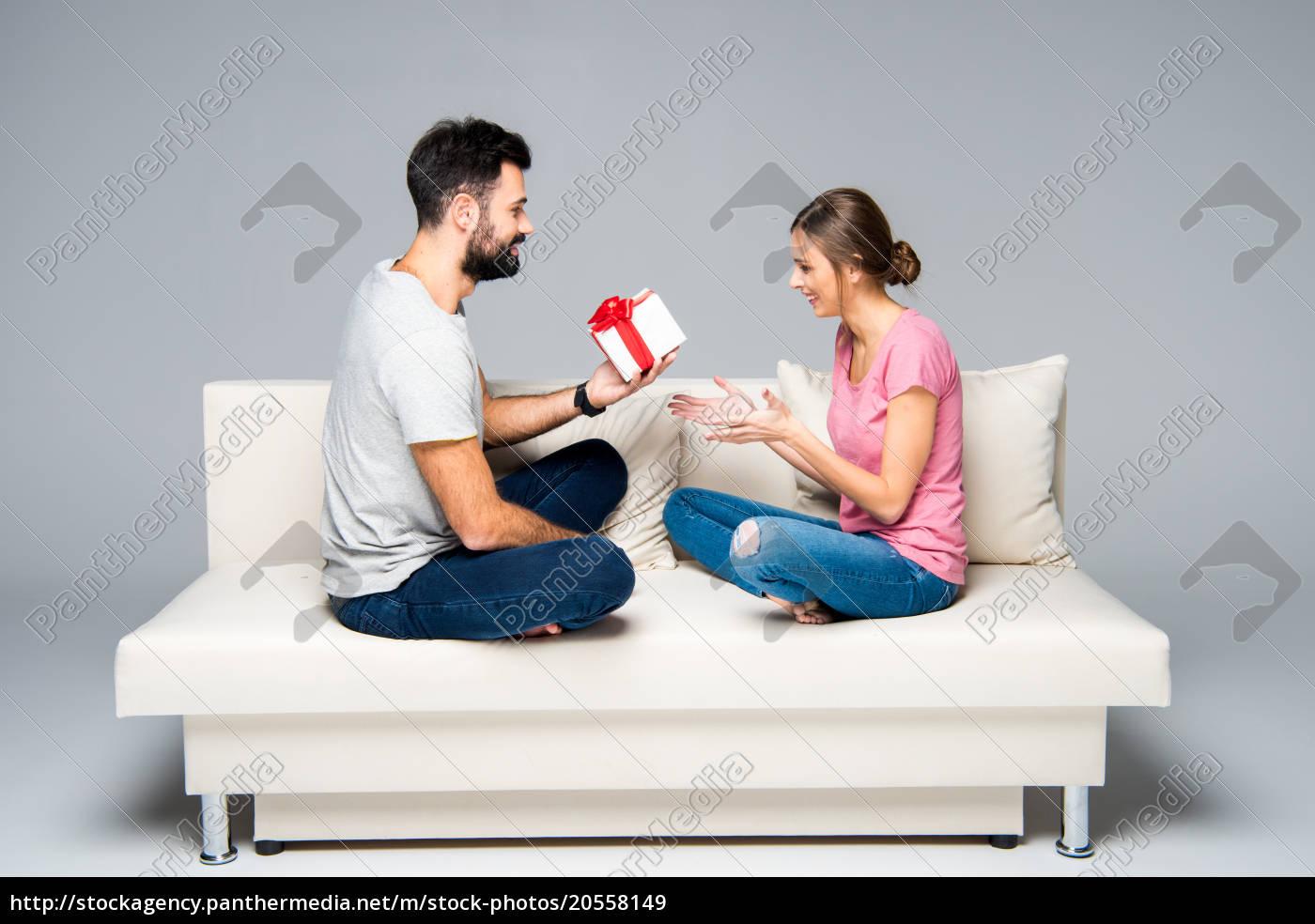 man, giving, gift, box, to, woman - 20558149
