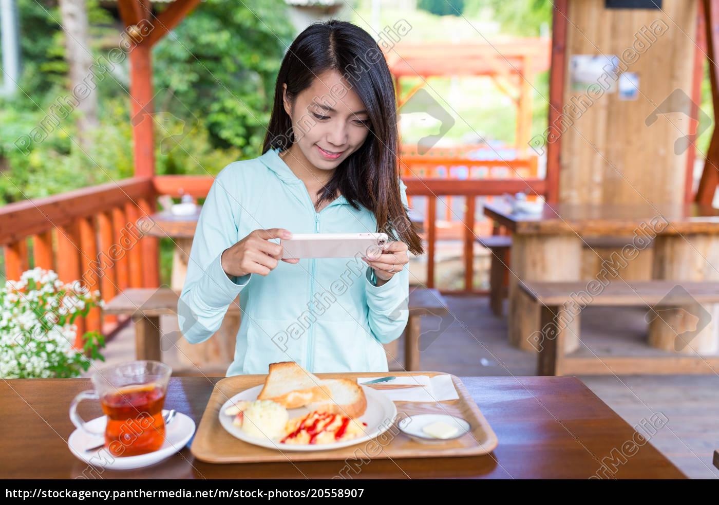 woman, taking, photo, on, her, breakfast - 20558907