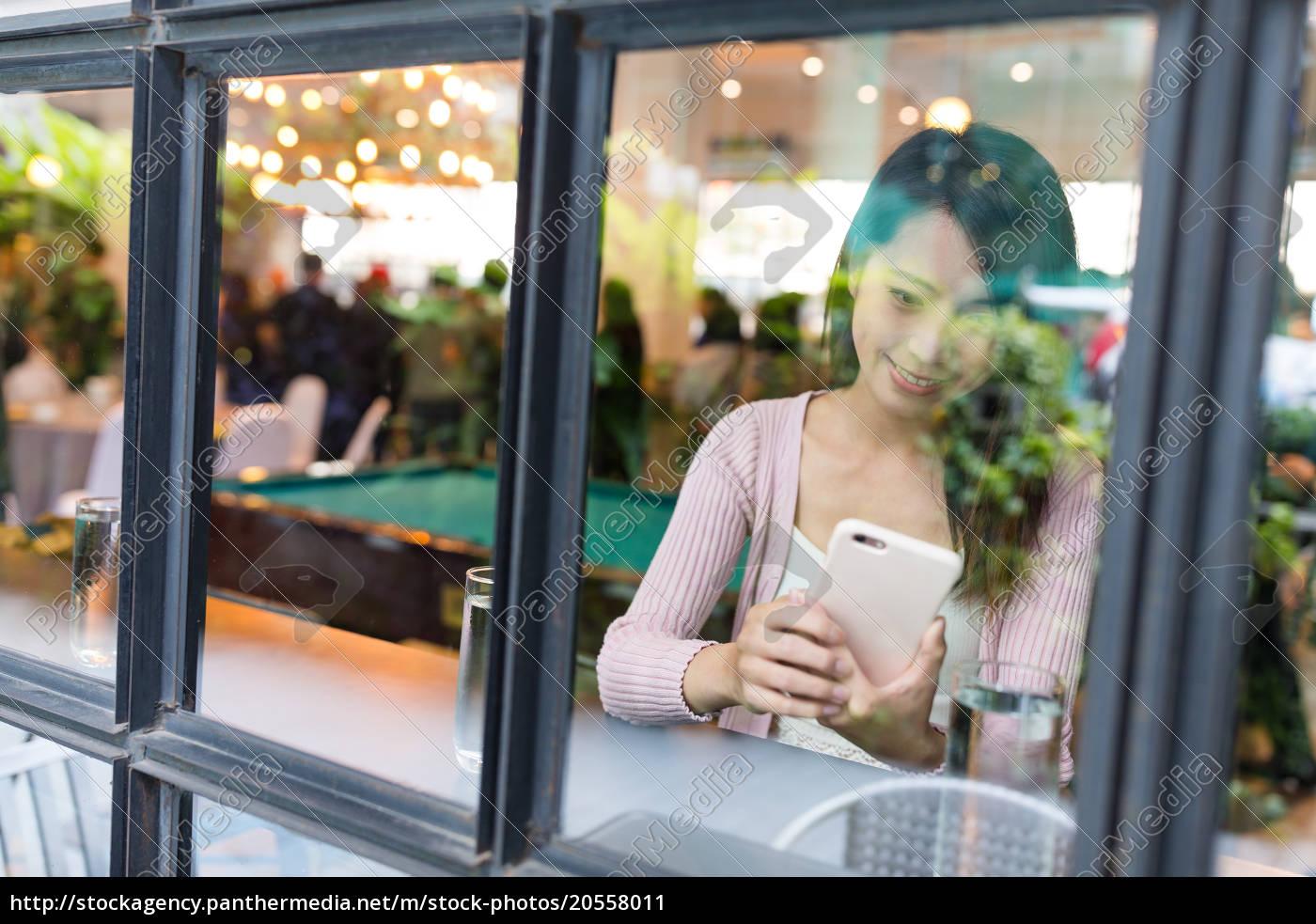 woman, working, on, cellphone, inside, coffee - 20558011