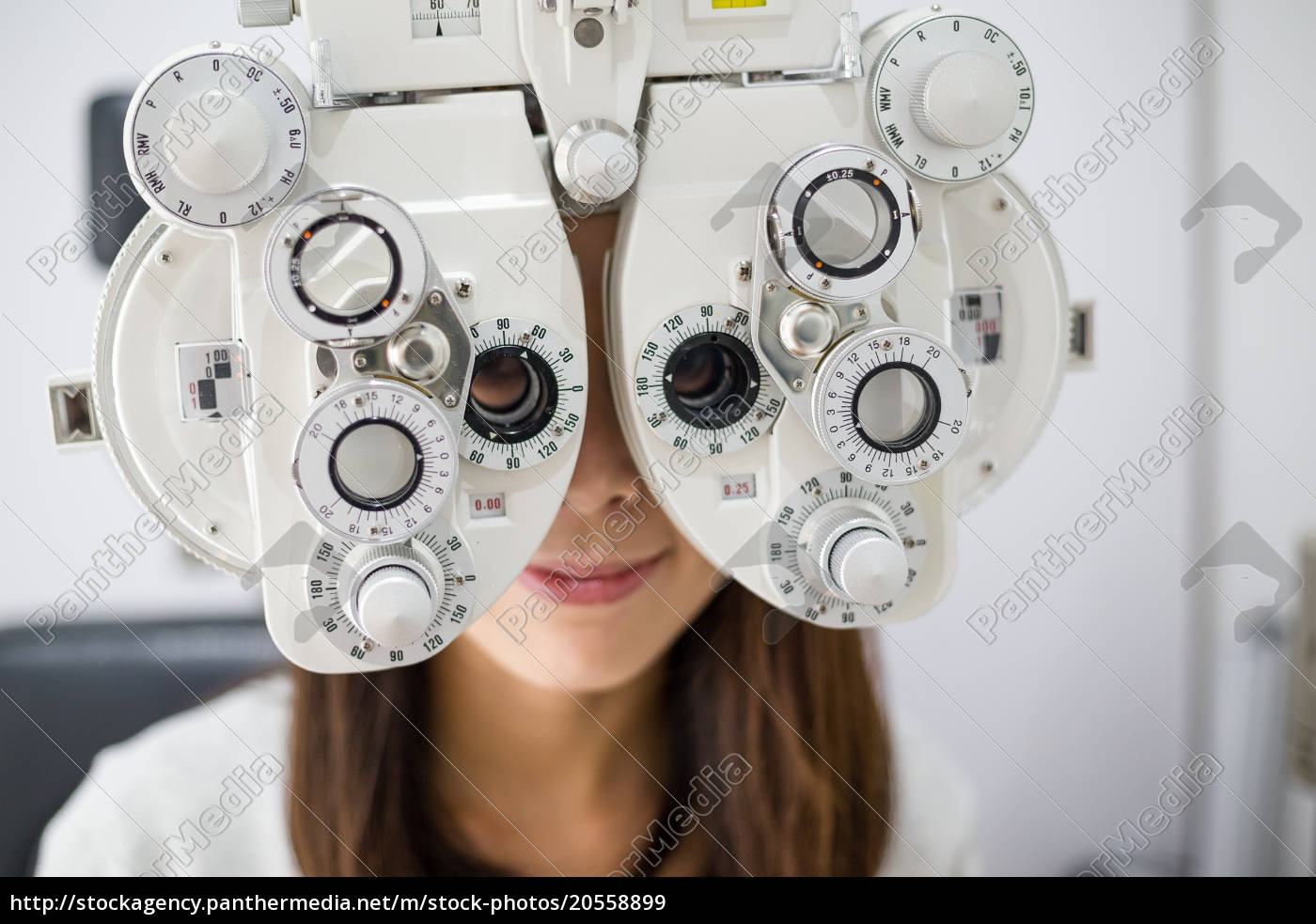 young, woman, doing, eye, test - 20558899