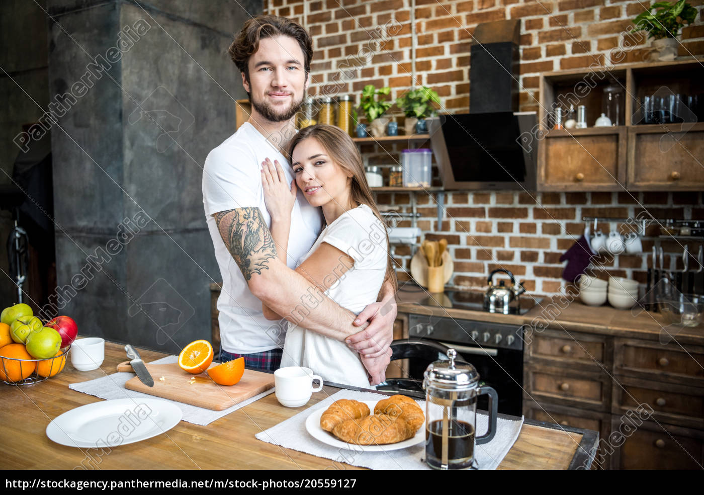 couple, hugging, in, kitchen - 20559127