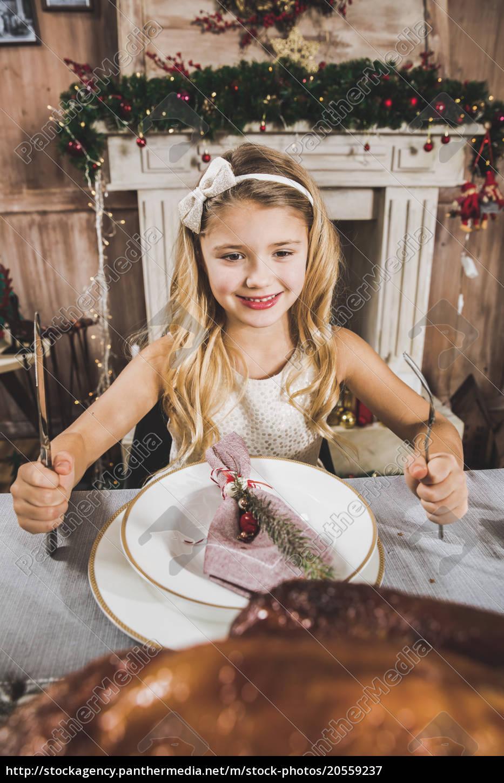 cute, girl, at, holiday, table - 20559237