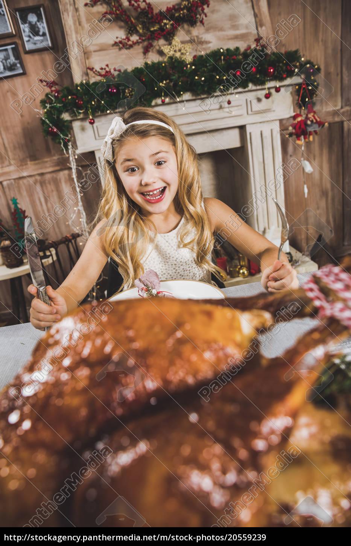 cute, girl, at, holiday, table - 20559239