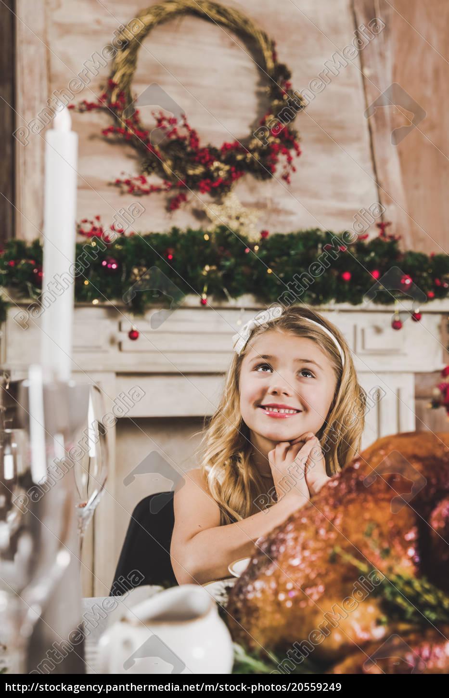 cute, girl, at, holiday, table - 20559249