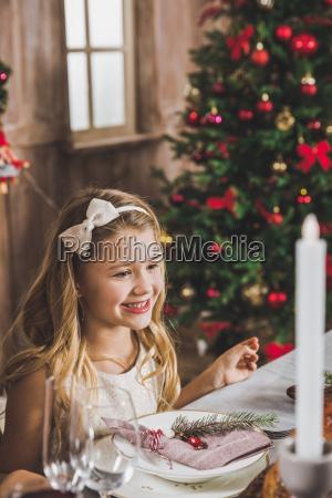 cute, girl, at, holiday, table - 20559271