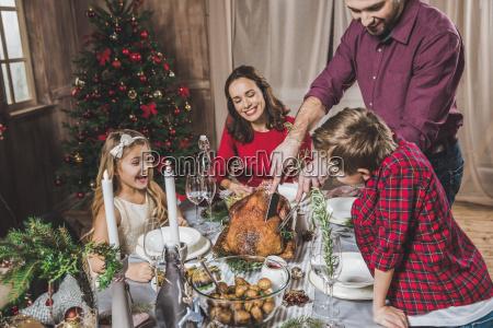 family, having, christmas, dinner - 20559401
