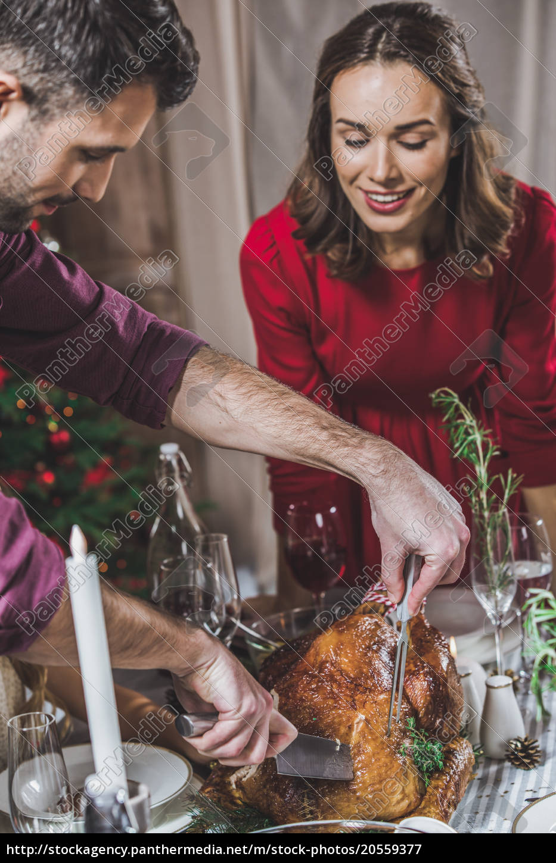 man, carving, roasted, turkey - 20559377