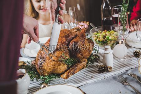man, carving, roasted, turkey - 20559397