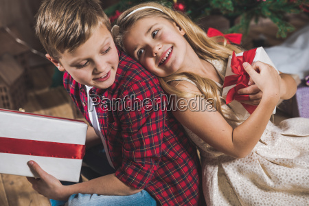 siblings, holding, gift, boxes - 20559327