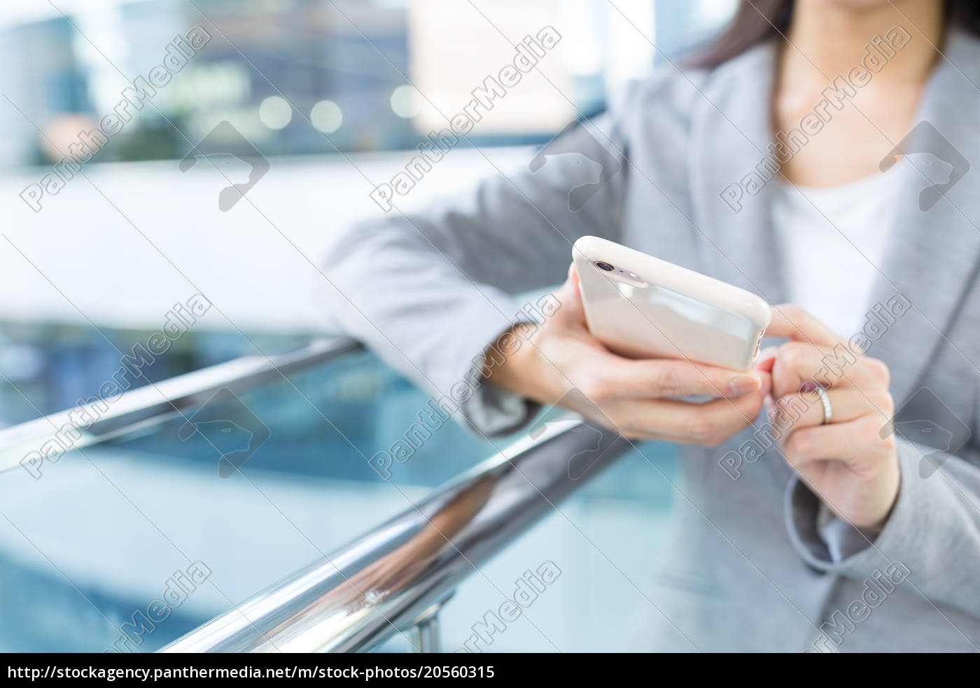 businesswoman, working, on, cellphone, at, outdoor - 20560315