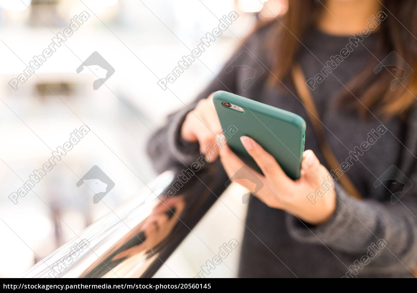 woman, sending, sms, on, mobile, phone - 20560145