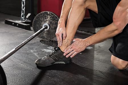 man having ankle pain