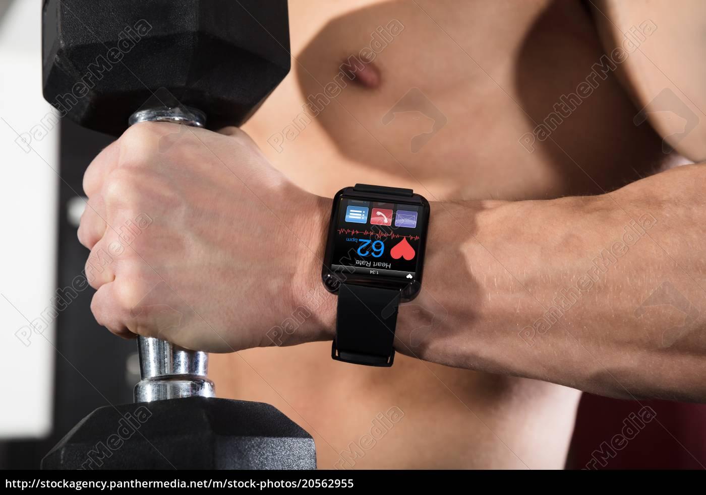 an, athlete, man, holding, dumbbell - 20562955