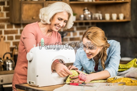 women using sewing machine
