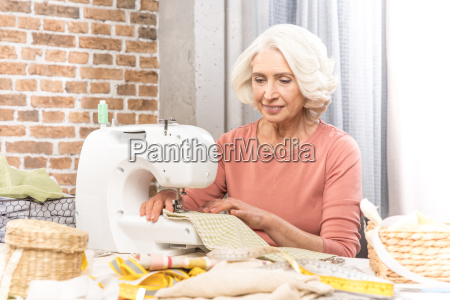woman with sewing machine
