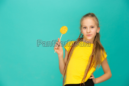 the, teen, girl, with, colorful, lollipop - 20566023