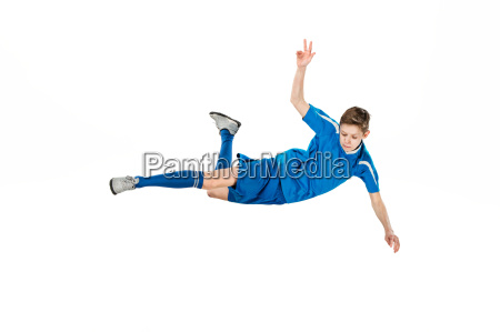 young, boy, with, soccer, ball, doing - 20566051