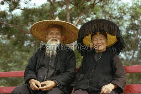 elderly hakka couple in traditional dress