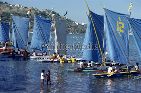 boats with blue sails line up
