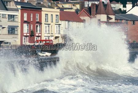 waves pounding sea wall and rail