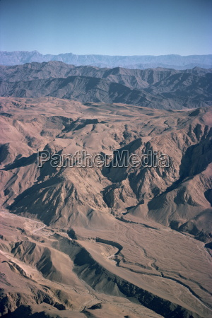 gullies and bare mountains in the